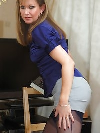 playful office chick inspects herself